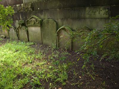 Gravestones line the perimeter sandstone wall