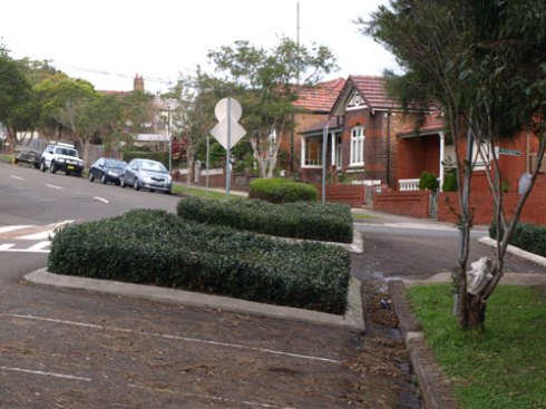 Simple, but effective landscaping in traffic islands just a little further up Kintore Street