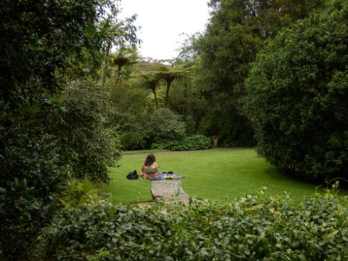 A woman & her baby having a quiet moment in the Camellia Gardens.
