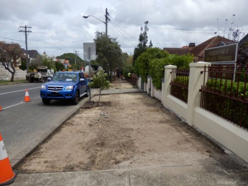 Another section stripped back before new footpath, verge gardens & street trees