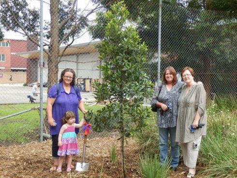 From left to right:  Jody, Emma, Kim & Jayne with Tom's tree.