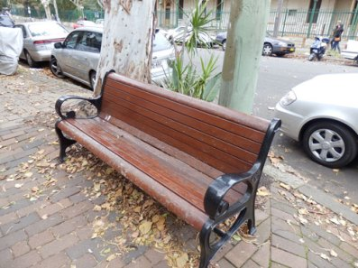 Unusual to see a park bench on the street.  It offered a great place to sit & look at the lane.  People did come to do exactly that in the short time I was there.  They came with their coffee made at home.