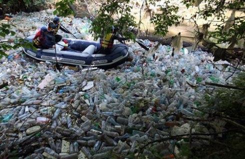 Plastic drink bottles choking  the  Juzna Morava River in Serbia.   Photo by Darko Vojinovic - Associated Press with thanks.