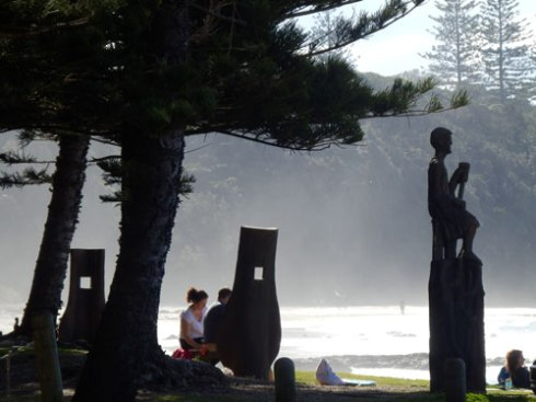 The Ned Kelly mask-like structures are benches made of huge pieces of wood.  The seats & the statue commemorate Harry, the unofficial Mayor of Shelley Beach who lived at the beach for 40-years.