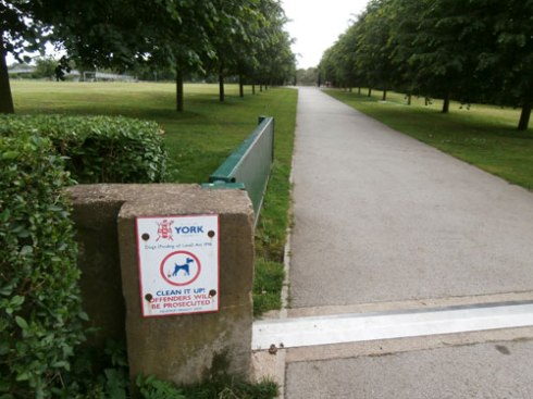 A beautiful entrance to Rowntree Park.  Note the dog poo sign.