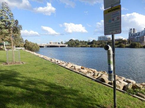 TAngler Bin & warning sign in Kendrick Park
