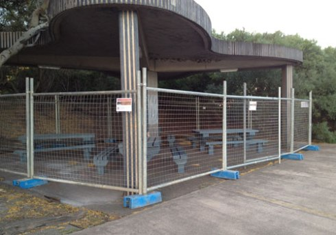 Temporary fencing around a kiosk in Tempe Reserve to protect the Fairy Martin mud nests during the breeding season.  Photo by Marrickville Council & used with thanks.