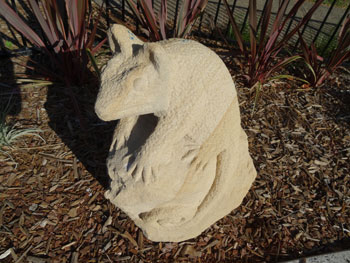 Little carved Possum - one of the two sculptures in the garden.