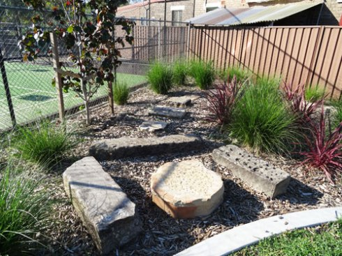 This area has been created to encourage children to explore the garden.   Paver in the lawn lead them to this area.  I think it is a lovely addition.