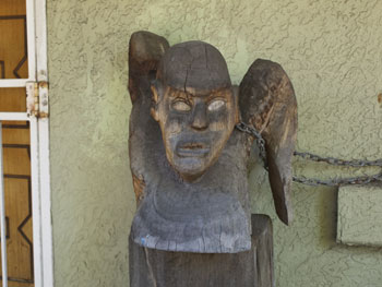 One of Hilik's sculptures on a front porch in Queen Street