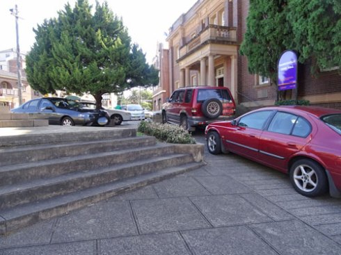 Unofficial car park.  Bollards will be removed offering more space.