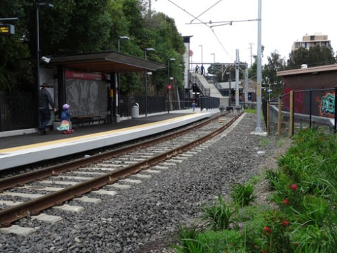 View of the Light Rail platform with the garden.  Dulwich Hill Railway Station is visible in the distance.