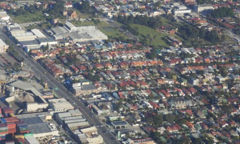 Sydenham from the air. The expanse of green space is Sydenham Green where there trees are planted mostly around the perimeter and along pathways.