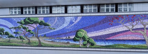 Mosaic on one of the buildings in the park