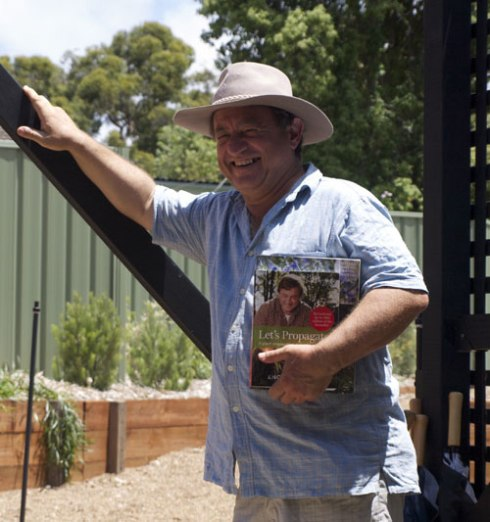 Angus Stewart holding a couple of his books.  We bought 'Lets Propagate,' which was written for Australia. At  282 pages it is packed with information & very useful for the gardener & the verge gardener.