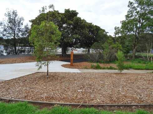 New trees & mulched areas at the entrance on the western side of Tempe Reserve