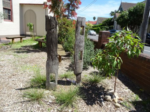 Two wonderful fence posts incorporated to create a very Australian design.  Note the Red Flowering gum tree, which will also add beauty & colour, as well as provide food for wildlife.