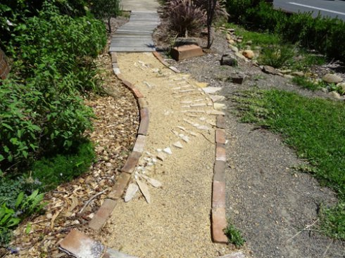 The paths really caught my attention.  They are permeable, using recycled materials & artistic.   They will be fascinating to children.