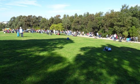 A great crowd of adults & kids  planting 6,000 plants & trees in Sydney Park for National Tree Day.