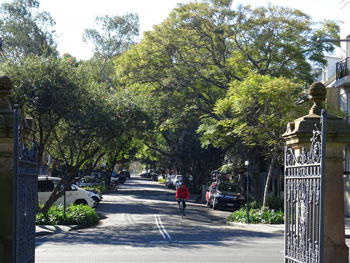 Showing the historic gates & a gorgeous street beyond.  Look at that canopy & so many verge gardens.  I bet it is a great street to live.