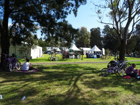 Showing some of the tents at the Cooks River Day Out.   They chose a great place to have it because there was lots of shady trees where people could get respite from the heat,