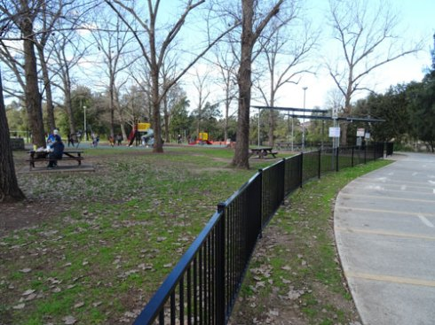 The fence extends along the bulk of the park