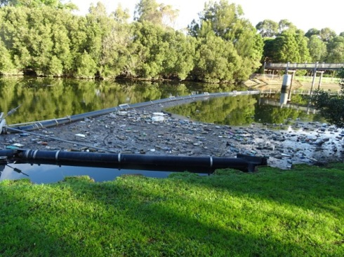 This litter catchment boom at Boat Harbour on the Cooks River fills faster than they empty it.  As the tide changes, all that cannot fit into the boom is carried back up the river often to get caught in the mangroves.